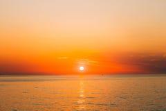 Sun Is Setting On Horizon At Sunset Sunrise Over Sea Or Ocean. T. Sun Is Setting On Horizon At Sunset Or Sunrise Over Sea Or Ocean. Tranquil Sea Ocean Waves Stock Image