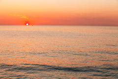 Sun Is Setting On Horizon At Sunset Sunrise Over Sea Or Ocean. T. Ranquil Sea Ocean Waves. Natural Sky Warm Colors. Panoramic View, Panorama. Copy Space Stock Photo