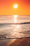 Sun Is Setting On Horizon At Sunset Sunrise Over Sea Or Ocean. Royalty Free Stock Photos