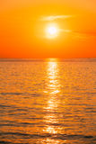 Sun Is Setting On Horizon At Sunset Sunrise Over Sea Or Ocean. Tranquil Sea Ocean Waves. Natural Sky Warm Colors Royalty Free Stock Images