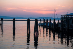 Sun setting at lake Stock Image
