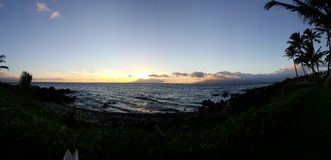Sun setting in maui. Sunset over the Pacific Ocean Royalty Free Stock Photography
