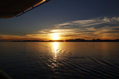 Sun setting in the middle of the sea Stock Image