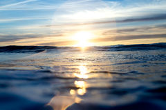 Sun Setting Over Blue Pacific Ocean Royalty Free Stock Image