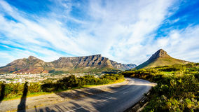 Sun setting over Cape Town, Table Mountain, Devils Peak, Lions Head and the Twelve Apostles Stock Images