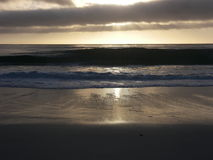 Sun setting over Carmel Beach Royalty Free Stock Photo