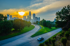 Sun setting over charlotte north carolina a major metropolitan c Royalty Free Stock Images