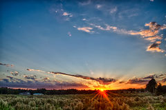 Sun setting over country farm land in york south carolina Royalty Free Stock Image