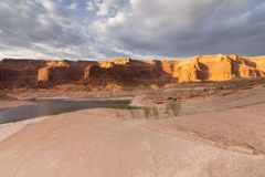 Sun setting over a cove at Lake Powell 1 royalty free stock photography