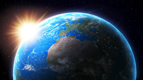 Sun setting over Earth Royalty Free Stock Images