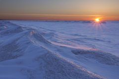 Sun Setting Over Frozen Lake Huron Royalty Free Stock Images