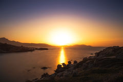 Sun setting over a Genoese tower and Calvi in Corsica Stock Image