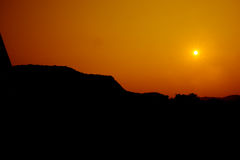 Sun setting over hills Royalty Free Stock Photo