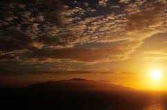 Sun setting over the horizon near the island of Brava Stock Photo