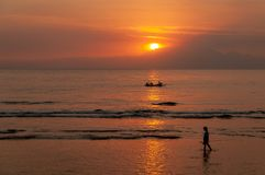 Sun setting over Indonesian fishermen - looking from Lombok towards Bali royalty free stock photo