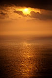Sun setting over the Mediterranean sea Royalty Free Stock Photos