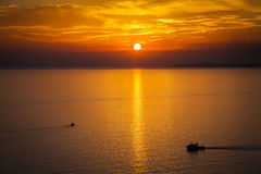 Sun setting over the Mediterranean sea Stock Photography