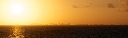 Sun Setting over Miami Skyline Stock Photo