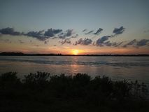 Sun setting over the Mississippi royalty free stock photography