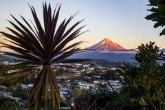 Mount Taranaki, New Plymouth, NZ. Sun setting over the Mount Taranaki, New Plymouth, New Zealand, Aotearoa Royalty Free Stock Photo