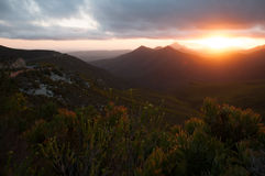 The sun setting over the mountain range of the Robinson pass. Stock Image
