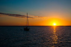 Sailing Setting Sun Stock Photography
