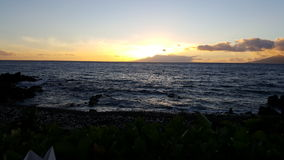 Sun setting over the Pacific. Ocean sunset maui hawaii Royalty Free Stock Photos
