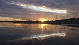 Sun setting over the Santa Barbara harbor Royalty Free Stock Images
