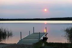 A sun setting over a Saskatchewan lake.  Royalty Free Stock Photo