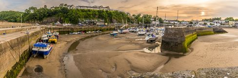 The sun setting over Saundersfoot harbour, Wales. A view of the sun setting over Saundersfoot harbour, Wales taken from the lighthouse in summer Stock Image