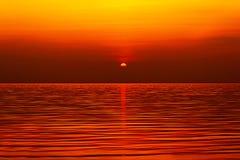 Sun setting over the sea Stock Image