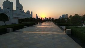 Sunset over Grand Mosque in Abu Dhabi  Stock Photos