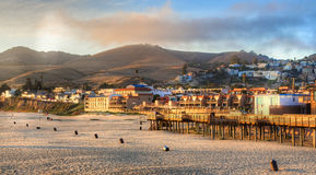 Sun setting on Pismo beach pier Royalty Free Stock Images