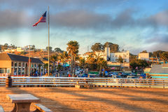 sun setting on Pismo beach pier Stock Images