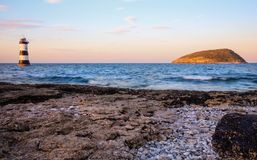 Sun setting on Puffin Island, North Wales Stock Images