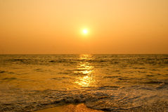 Sun setting in a sea beach. Scenic view of sun set ,shot in the beaches of Alleppey located in South India Stock Image