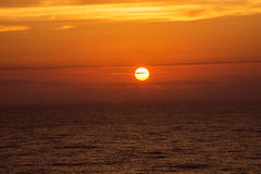 Sun Setting at Sea Royalty Free Stock Image