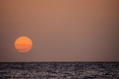 The  Sun Setting in the Sea Stock Photography