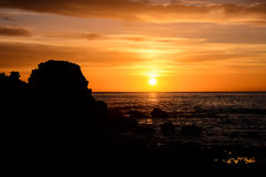 The  Sun Setting in the Sea Royalty Free Stock Images