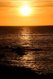 The  Sun Setting in the Sea Stock Photos