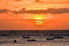 The  Sun Setting in the Sea Stock Image