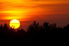 Sun Setting in a Smoky Western Sky Stock Photos