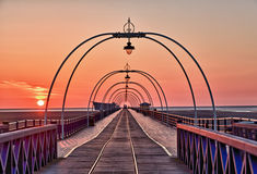 Sun setting on Southport pier Royalty Free Stock Images