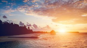 Sun setting on a tropical island royalty free stock photography