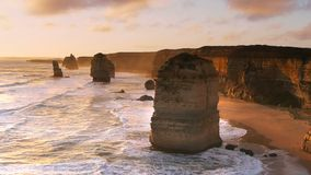 Sun setting at the twelve apostles. The iconic twelve apostles near melbourne, australia at sunset stock footage