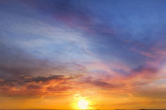 Sun setting in vibrant sky Stock Images