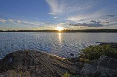 Sun Setting on a Wilderness Lake Stock Photos