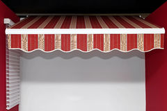 Sun shade. Red stripes canopy at retractable sun shade stock photos