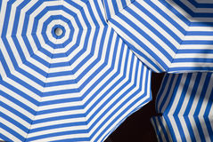 Sun Shade. Overlapping sun shade umbrellas with white and blue stripes stock photo