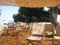 Sun shade in a caffe on the beach. Skiathos, Greece Royalty Free Stock Image